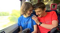 Couple visiting all British railway stations