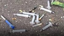 Boy finds needles scattered in woodland