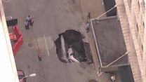 Sinkhole swallows car in St Louis
