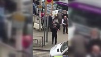 Moment police arrest man with machete