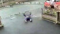 CCTV captures moment car strikes pair