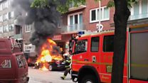 G20: Burning vehicles and water cannons