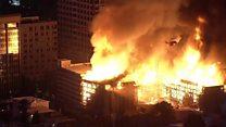 Massive fire engulfs blocks of flats