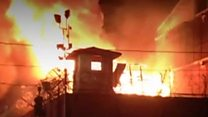 Inmates escape as prison burns