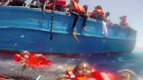 Child migrants in sea pulled to safety