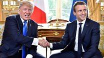 Toned-down Trump's shifting tone in Paris