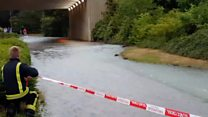 Water pours down pathway as main bursts