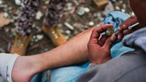 Life in an open-air heroin camp