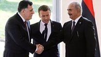 Libyan rivals in rare handshake