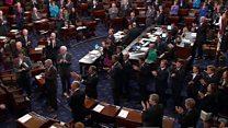 McCain enters Senate to cast deciding vote