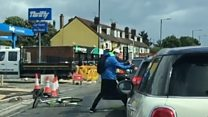 Cyclist and driver filmed fighting