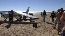 Plane landing on Portugal beach
