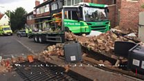 CCTV footage shows low-loader shop crash