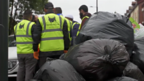 Volunteers clear rubbish from streets