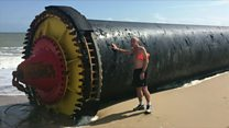Giant pipes wash up on beaches