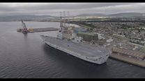 Drone films carrier before landing on deck