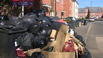 Bin bag piles cost city '£40,000 a day'