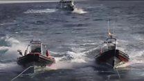 Migrant rescue ship threatened by Libyan coastguard