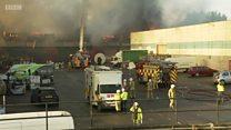 Firefighters tackle huge warehouse blaze