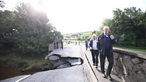 Bridge collapses in flooding