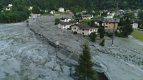 Landslide engulfs village in Swiss Alps