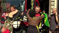 Carnival goers hug Grenfell firefighters