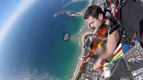 Naked skydiving musician plays violin