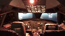 Behind the controls of a commercial aircraft