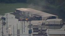 Aerials show flooded chemical plant fire