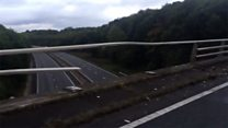 Driver perilously close to bridge drop