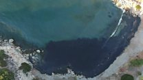 Oil spill turns Greek island bay black