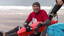 Surfers with disabilities hit the waves