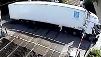 Lorry driver crashes into level crossing