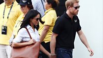 Harry and Meghan hold hands