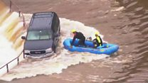Woman rescued from flooded road