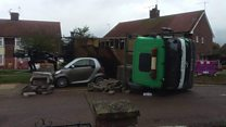 Lorry carrying blocks topples on to car