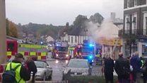 Crews fight town centre bike shop blaze