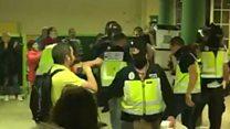 Balaclava-clad police seize ballots