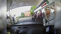 Taxi driver tackles two armed robbers