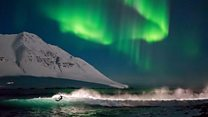 Catching waves under Iceland's Northern Lights
