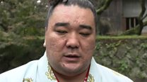 Sumo wrestler sorry for 'causing trouble'