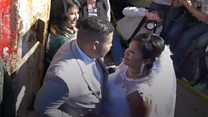 'We married through Mexico border fence'