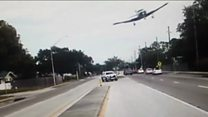 Plane smashes into highway