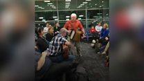 Flight delay turns into mass singalong