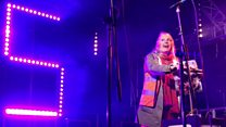 Popular postie Sam Weight switches on Christmas lights