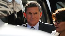 Crowds shout at Michael Flynn at court