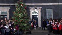 Theresa May and helpers turn on Christmas tree lights