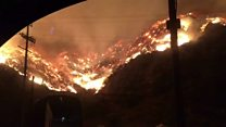 Wildfires surround LA freeway
