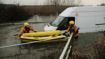 Firefighters rescue man from flooded car