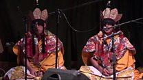 Manaich à Tibet air thuras ann an Alba
